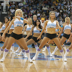 25 March 2009: New Orleans Hornets Honeybees dance team performs during a NBA game between the New Orleans Hornets and the Denver Nuggets at the New Orleans Arena in New Orleans, Louisiana.