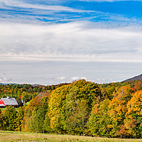 The Vermont red barn and beautiful fall foliage, near Stowe, Vermont.