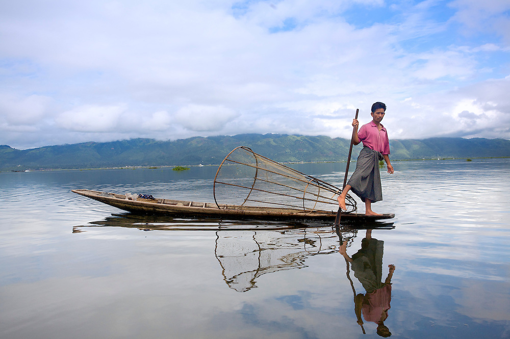 Intha man demonstrating leg rowing, Inle Lake, Myanmar.