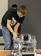 Kevin Simons, 15, sophomore, of Linn-Mar High School works on his teams robot after a qualification match at the FTC Qualifying Tournament held at Linn-Mar High School at 3111 North 10th Street in Marion on Saturday November 19, 2011. (Stephen Mally/Freelance)
