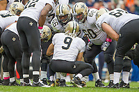 06 October 2013: Quarterback (9) Drew Brees of the New Orleans Saints calls a play in the huddle against the Chicago Bears during the second half of the Saints 26-18 victory over the Bears in an NFL Game at Soldier Field in Chicago, IL.