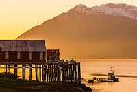 Chilkat Inlet, near Mud Bay, Haines, Alaska USA. Haines is surrounded by mountains and water. Rising high above the town are the Takinsha Mountains and Chilkat Range to the south, Takshanuk Mountains to the north and Coast Mountains to the east across the Lynn Canal.