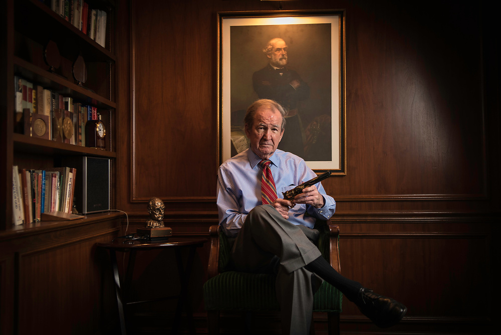 MCLEAN, VA -- 3/21/17 -- Buchanan holds his Robert E. Lee replica revolver as he sits for a photo under the portrait of the Confederate general. His family fought for the Confederacy. Respected conservative commentator Pat Buchanan reflects on his career at his home in McLean. .…by André Chung #_AC24179