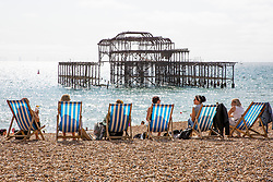 © Licensed to London News Pictures. 13/09/2020. Brighton, UK. Members of the public take to the beach in Brighton And Hove as sunny and warm weather is hitting the seaside resort. Photo credit: Hugo Michiels/LNP