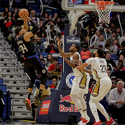 Dec 3, 2018; New Orleans, LA, USA; LA Clippers forward Tobias Harris (34) shoots over New Orleans Pelicans forward Darius Miller (21) and forward Anthony Davis (23) during the second half at the Smoothie King Center. Mandatory Credit: Derick E. Hingle-USA TODAY Sports
