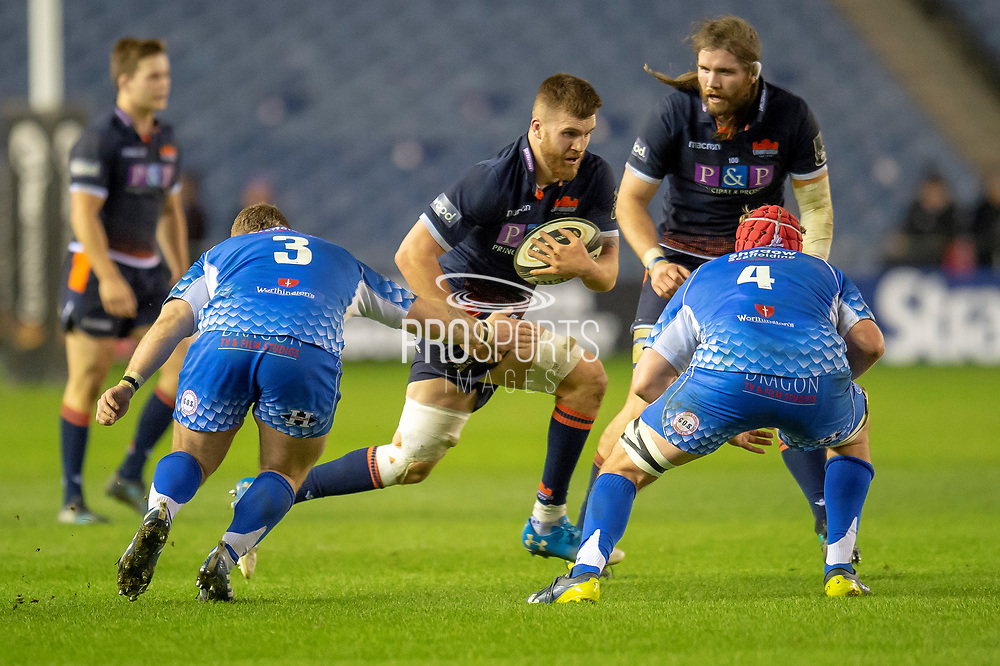 Luke Crosbie (#7) of Edinburgh Rugby charges at Lloyd Fairbrother (#3) and Joe Davies (#4) of Dragons Rugby during the Guinness Pro 14 2018_19 match between Edinburgh Rugby and Dragons Rugby at BT Murrayfield Stadium, Edinburgh, Scotland on 15 February 2019.