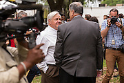 North Charleston Mayor Keith Summey and Police Chief Eddie Driggers surrounded by media, wait for a peace vigil to begin held by Rev. Al Sharpton on the spot where unarmed motorist Walter Scott was gunned down by police April 12, 2015 in North Charleston, South Carolina. About 100 people showed up for the brief vigil following a healing service at Charity Mission Baptist Church.
