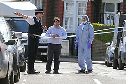 © Licensed to London News Pictures. 01/06/2019. London, UK. A police officer speaking with a man within the crime scene on Seven Sisters Road, near the junction of Vartry Road in Haringey, north London, where a man in his 30s was found suffering from a stab wound to his leg. Police were called by London Ambulance Service just after 3am on Saturday, 1 June 2019. The victims condition in unknown.  Photo credit: Dinendra Haria/LNP