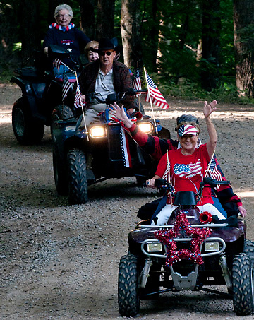 People participate in the 2011 July 4 ATV Parade at Cattail Creek Community near Burnsville, NC.