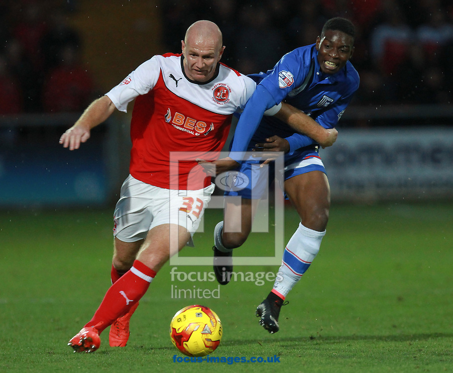 Stephen Crainey of Fleetwood Town and Jermaine McGlashan of Gillingham during the Sky Bet League 1 match at the Highbury Stadium, Fleetwood<br /> Picture by John Rainford/Focus Images Ltd +44 7506 538356<br /> 01/11/2014