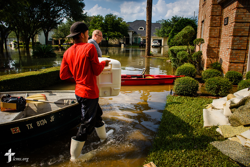 David Kunz of Memorial Lutheran Church, Houston, (in grey) is helped by a volunteer from Miami as the two carry  meals to flood victims from Hurricane Harvey on Monday, Sept. 4, 2017, in Houston. LCMS Communications/Erik M. Lunsford