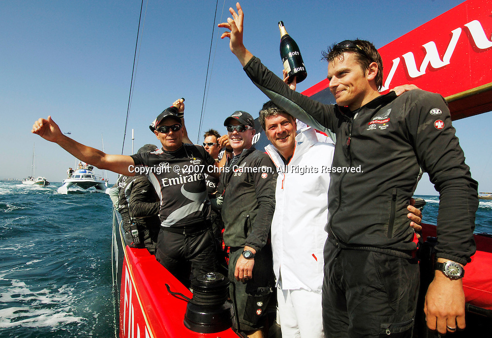 Emirates Team New Zealand MD Grant Dalton, Terry Hutchinson, Yves Carcelle, the President and CEO of Louis Vuitton and Dean Barker aboard NZL92 after their 5 - 0 win of the Louis Vuitton Cup finals.<br /> Valencia, Spain<br /> Wednesday 6 June 2007<br /> Photo: Chris Cameron/PHOTOSPORT