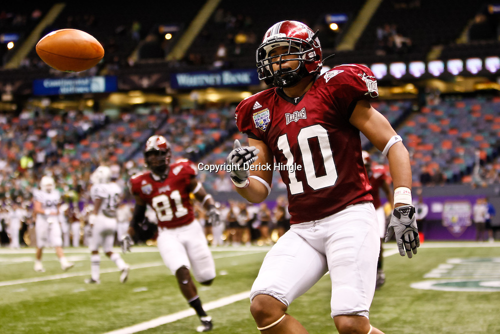 December 18, 2010; New Orleans, LA, USA; Troy Trojans wide receiver Tebiarus Gill (10) celebrates following a touchdown against the Ohio Bobcats during the first half of the 2010 New Orleans Bowl at the Louisiana Superdome.  Mandatory Credit: Derick E. Hingle
