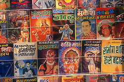 Closeup of comics displayed on road side comic stall,