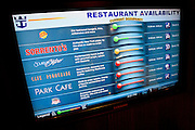 A monitor shows seat availability at the various restaurants onboard the Oasis of the Seas, the largest cruise ship in the world.