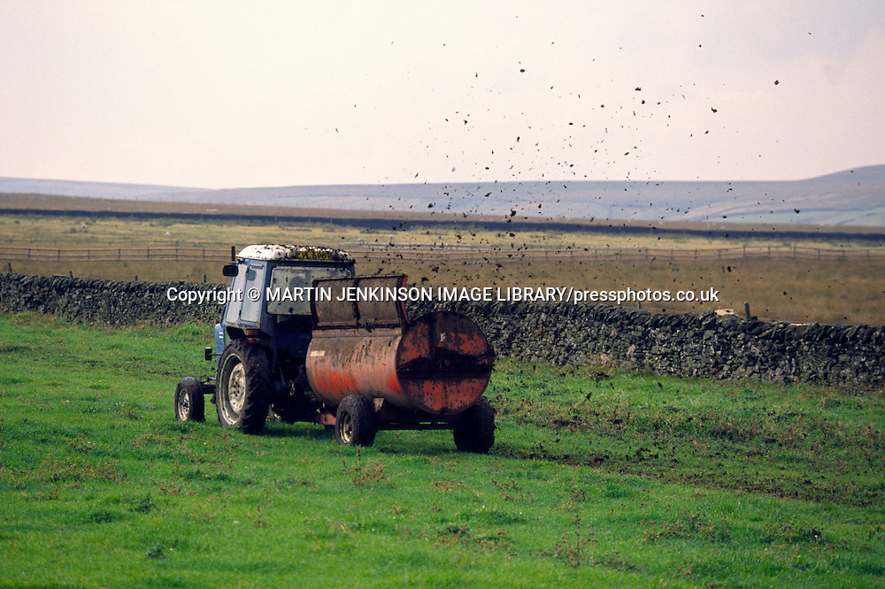 muck spreading on a farm ....