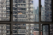 Apartment blocks are seen from the window of a facing building in Chongqing, China, Sunday, Nov. 2, 2008.
