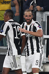 September 27, 2017 - Turin, Italy - Juventus forward Gonzalo Higuain (9) celebrates with his teammates after scoring his goal during the Uefa Champions League group stage football match n.2 JUVENTUS - OLYMPIACOS on 27/09/2017 at the Allianz Stadium in Turin, Italy. (Credit Image: © Matteo Bottanelli/NurPhoto via ZUMA Press)
