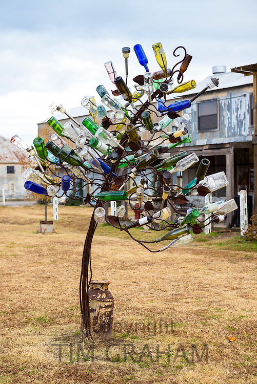 Wacky modern art sculpture of empty bottles at The Shack Up Inn cotton sharecroppers theme hotel, Clarksdale, Mississippi USA