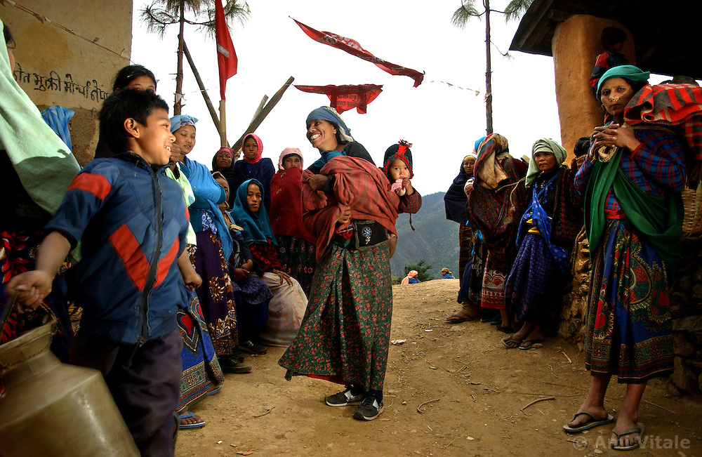 More than 20 Communist flags are draped in trees and throughout a small village signaling that the Maoists are in firm control of the region in Tila, Rolpa district in Western Nepal March 12, 2005. Ami Vitale)