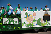 "The ""Dirk Nowitzki: World's Tallest Leprechaun"" float throws beads to the crowd at the Dallas St. Patrick's Parade on Greenville Avenue, Saturday, March 16, 2013. (Cooper Neill/The Dallas Morning News)"