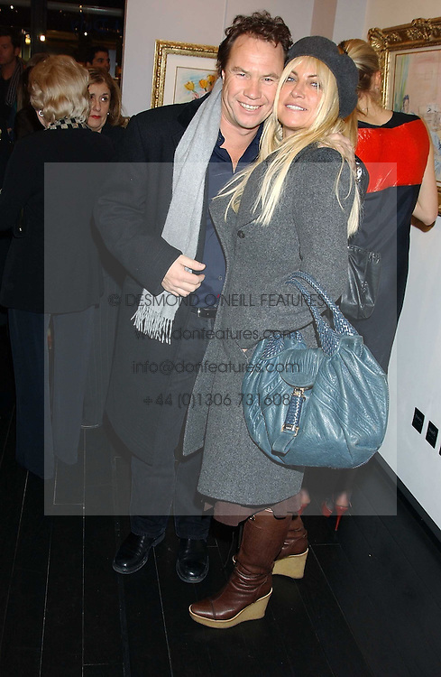 MEG MATHEWS and JOHN HITCHCOX at the opening of an exhibition of paintings and watercolours by Raoul Dufy held at the Opera Gallery, 134 New Bond Street, London W1 on 6th February 2006.<br /><br />NON EXCLUSIVE - WORLD RIGHTS
