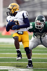 12 November 2011:  Antonio Owens looks over his shoulder to see Joe Krob looking for him during an NCAA division 3 football game between the Augustana Vikings and the Illinois Wesleyan Titans in Tucci Stadium on Wilder Field, Bloomington IL