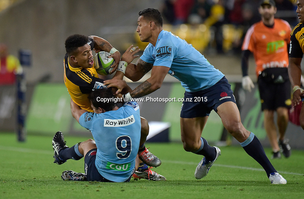 Hurricanes' flank Ardie Savea (Top L) is tackled by Waratahs' Nick Phipps (Bottom) and Israel Folau during the Super Rugby - Hurricanes v Waratahs rugby union match at the Westpac Stadium in Wellington on Saturday the 18th of April 2015. Photo by Marty Melville / www.Photosport.co.nz