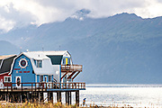Tourist shops and restaurants on Homer Spit on Kachemak Bay in Homer, Alaska. Homer is known as the End of the Road and is surrounded by wilderness and ocean.