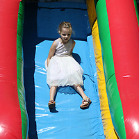 Emma King, 7, slides down one of the inflatable Saturday at the Easter Egg Hunt held at Veterans park hosted by Connect Church and Whitehill MB Church