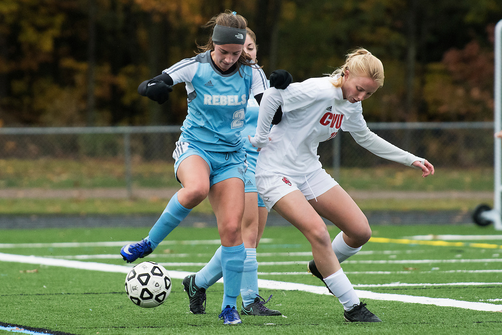 CVU's Sierra Morton (15) battles for the ball with South Burlington's Sonya Heldman (2) during the girls high school playoff game between the Champlain Valley Union Redhawks and the South Burlington Rebels at South Burlington High School on Saturday afternoon October 29, 2016 in South Burlington. (BRIAN JENKINS/for the FREE PRESS)