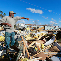 Thomas Wells   BUY AT PHOTOS.DJOURNAL.COM<br /> Will Poplar of Walnut points out where he found himself after in his mobile home along Highway 72 on Monday following last weeks tornado. Poplar suffered a fractured hip as his only major injury.