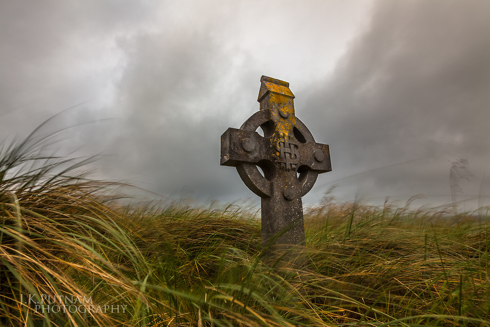 A celtic cross in a small cemetery on Inisheer, one of the Aran Islands of Ireland.