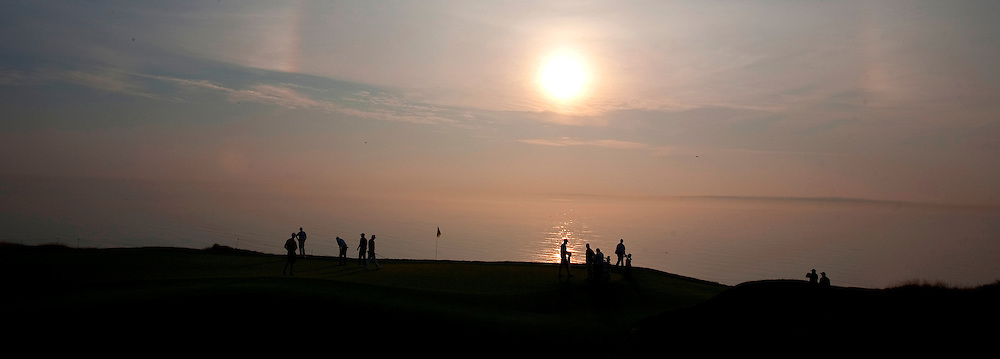 pga11, spt, lynn, 3.-Golfers are sillouetted on the third green as the sun rises over Lake Michigan suring the second day of practice at Whistling Straits in Haven, WI Tuesday August 10, 2010.  Photo by Tom Lynn/TLYNN@JOURNALSENTINEL.COM