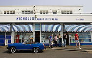 (West Kirby, UK - April 22, 2011) -  Nicholl's Ice Cream is a popular stop on a warm Spring day in West Kirby, a beach town outside of Liverpool. Photo by Will Nunnally / Will Nunnally Photography