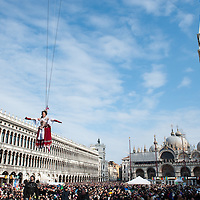 A Venetian girl performs as 'Colombina' during the Volo dell'Angelo, as she flies down from San Marco Tower to the square during the official opening of Venice Carnival