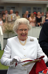 HM THE QUEEN ELIZABETH 11 presents prizes at the Queen's Cup polo final sponsored by Cartier at Guards Polo Club, Smith's Lawn, Windsor Great Park on 18th June 2006.  The Final was between Dubai and the Broncos polo teams with Dubai winning.<br />