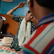 "Nanjamma is a CBR worker. Here in one the urban slums of Bangalore she is giving speech therapy and sign language lessons to Shiva, a ten year old boy who is hearing impaired as his grandfather watches in the back..Nanjamma is 23 and suffered from polio as a child. She became aware of disability issues through a CBR worker who visited her slum and decided to become involved. She took a training course at APD and now works with 60 disabled children in the slums of Bangalore. ""The CBR worker gave me a lot of motivation and I decided that I wanted to become a CBR myself. My salary is only Rs 2,800 (about 35 GBP) a month but I am very happy. I do social work and help others"" she says."