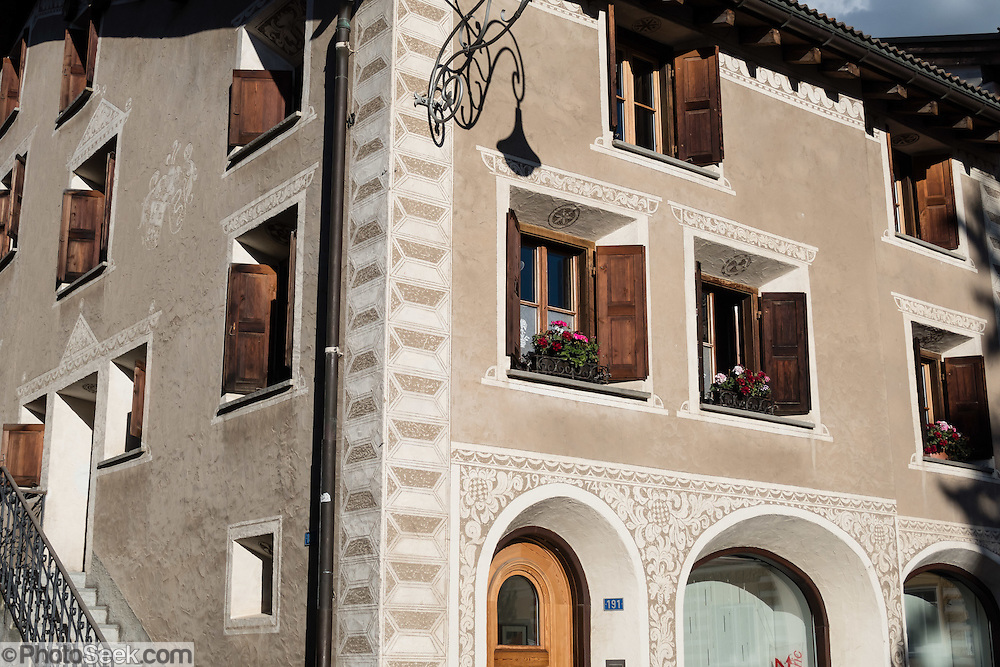 """Scraffiti decorates houses in Pontresina, in Upper Engadine, Graubünden (Grisons) canton, Switzerland, the Alps, Europe. The Swiss valley of Engadine translates as the """"garden of the En (or Inn) River"""" (Engadin in German, Engiadina in Romansh, Engadina in Italian)."""