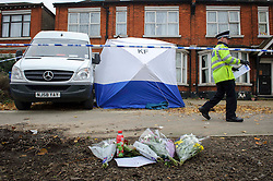 © Licensed to London News Pictures. 03/12/2013 London, UK. A police officer stands outside a house on the North Circular Road where a  teenager has been stabbed to death. Officers were called to the address  in Palmers Green where they found the 17-year-old from Haringey. Photo credit : Simon Jacobs/LNP
