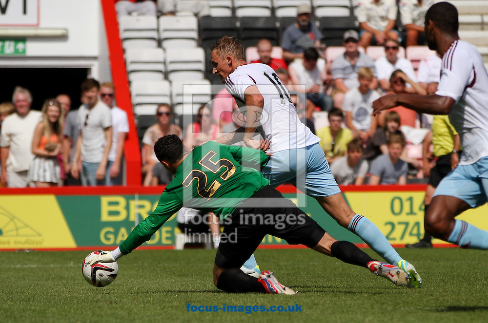 Picture by Tom Smith/Focus Images Ltd 07545141164<br /> 13/07/2013<br /> Jack Collison (centre) of West Ham United rounds the keeper to score during the Stephen Purches testimonial pre season friendly match at the Seward Stadium, Bournemouth.