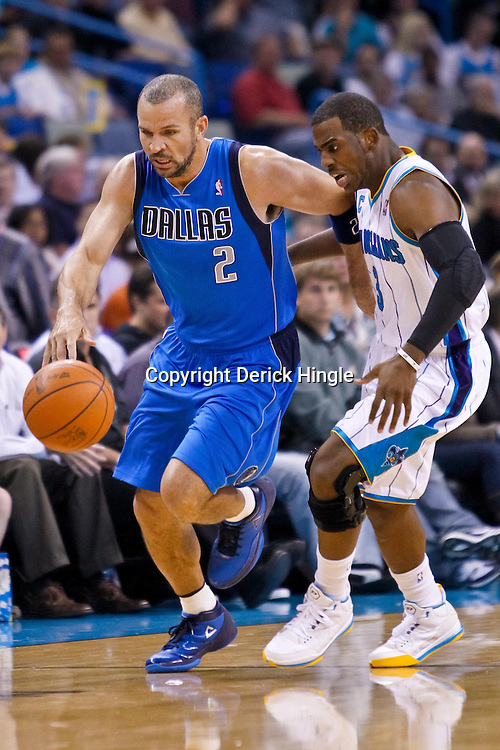 November 17, 2010; New Orleans, LA, USA; Dallas Mavericks point guard Jason Kidd (2) drives past New Orleans Hornets point guard Chris Paul (3) during the first quarter at the New Orleans Arena. Mandatory Credit: Derick E. Hingle