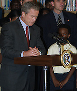 President George W. Bush pauses for a moment of silence after announcing the terrorist attacks on the World Trade Center on September 11, 2001.  The president was visiting Booker Elementary School in Sarasota, Florida.