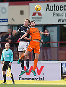 August 9th 2017, Dens Park, Dundee, Scotland; Scottish League Cup Second Round; Dundee versus Dundee United; Dundee's Kevin Holt beats Dundee United's Sam Stanton in the air