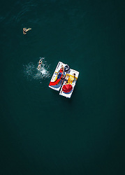 THEMENBILD - Menschen schimmen neben zwei Tretboote im Zeller See, aufgenommen am 30. Juni 2019 in Zell am See, Österreich // People swimming next to two pedal boats in Lake Zell, Zell am See, Austria on 2019/06/30. EXPA Pictures © 2019, PhotoCredit: EXPA/ JFK