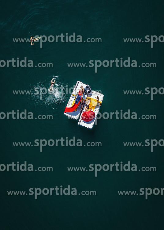 THEMENBILD - Menschen schimmen neben zwei Tretboote im Zeller See, aufgenommen am 30. Juni 2019 in Zell am See, Österreich // People swimming next to two pedal boats in Lake Zell, Zell am See, Austria on 2019/06/30. EXPA Pictures © 2019, PhotoCredit: EXPA/ JFK