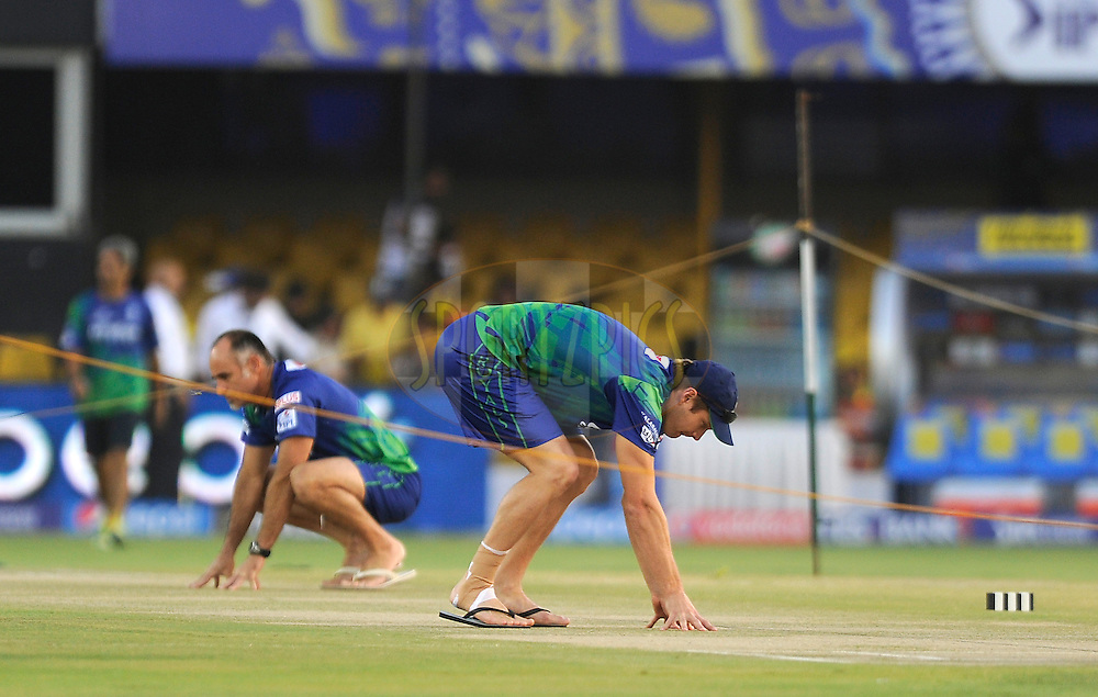 Shane Watson captain of Rajasthan Royals has a closer look at the pitch during a practice session before the start of match 22 of the Pepsi IPL 2015 (Indian Premier League) between The Rajasthan Royals and The Royal Challengers Bangalore held at the Sardar Patel Stadium in Ahmedabad , India on the 24th April 2015.<br /> <br /> Photo by:  Pal Pillai / SPORTZPICS / IPL