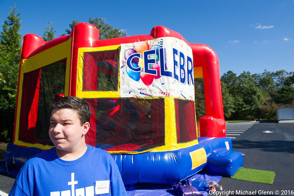 15 Oct. 2016 Forked River USA / Nicholas Cox is ready to man the bouncy House as St Pius X celebrates it's 10th year in their new church with a festival open to all  /  Michael Glenn  / Glenn Images