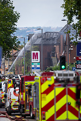 Firefighters spray water on the charred roof at the scene of a fire at The Mall in Walthamstow in North East London, that broke out during rush hour this morning and appears to have destroyed the foodcourt and according to a manager escorted by LFB officials at the adjacent Asda, a large amount of stock. London, July 22 2019.