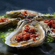 Smoked Basque Oysters served at Viaggio Tapas in Rockville Centre, N.Y.
